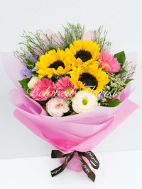 Bouquet includes 3 Sunflowers + 3 Gerberas with matching flowers. The bouquet is wrapped with hand-made flower papers and ribbons.