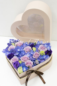 Purple hydrangea and roses in a heart box