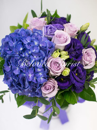 Purple hydrangea and roses in a box